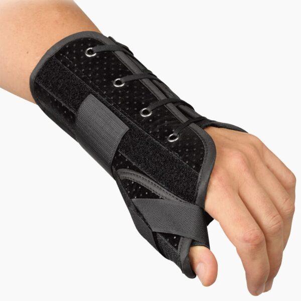 Handledsortos - Wrist Lacer m. tumstöd